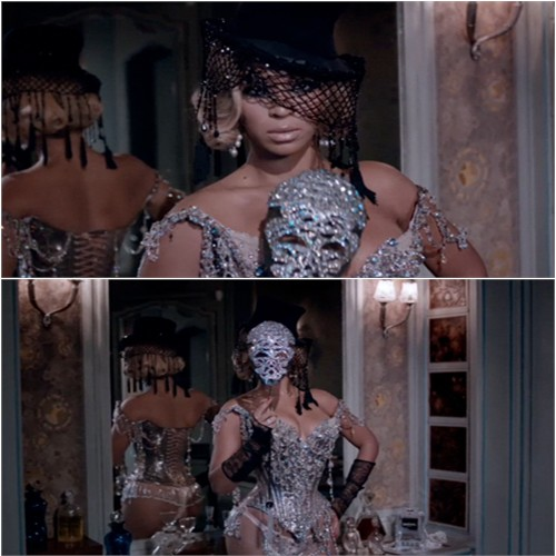 corset by Christian Lacroix, mask by Swarovski, gloves by Chanel